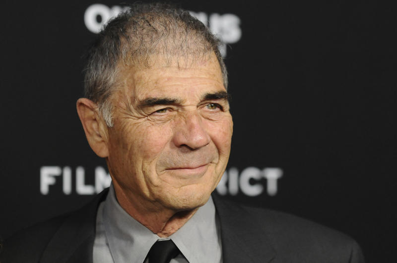 "FILE - In this Monday, March 18, 2013 file photo, Robert Forster arrives at the LA premiere of ""Olympus Has Fallen"" at the ArcLight Theatre in Los Angeles. Forster, the handsome character actor who got a career resurgence and Oscar-nomination for playing bail bondsman Max Cherry in ""Jackie Brown,"" has died at age 78.