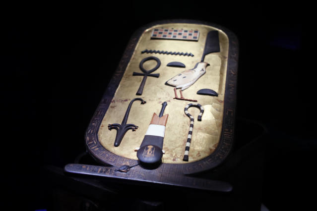 An inlaid wooden cartouche box is displayed as part of 'Tutankhamun, the treasure of the Pharaoh', an exhibition in partnership with the Grand Egyptian Museum at the Grande Halle of La Villette in Paris, France, Thursday, March 21, 2019. This exhibition, which runs from 23 March to 15 September 2019. will reveal 150 fascinating original objects found in 1922 in the tomb of the most famous Pharaoh. (AP Photo/Francois Mori)