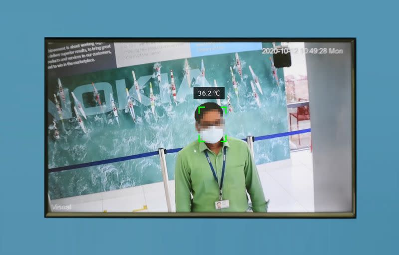 An undated Handout image shows an employee going through Nokia's automated COVID-19 detection system in Chennai