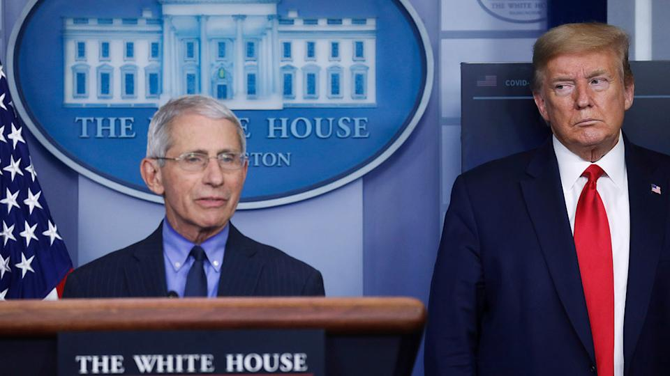 President Donald Trump looks on as Dr. Anthony Fauci answers a question at a coronavirus task force briefing in April 2020. (Leah Millis/Reuters)