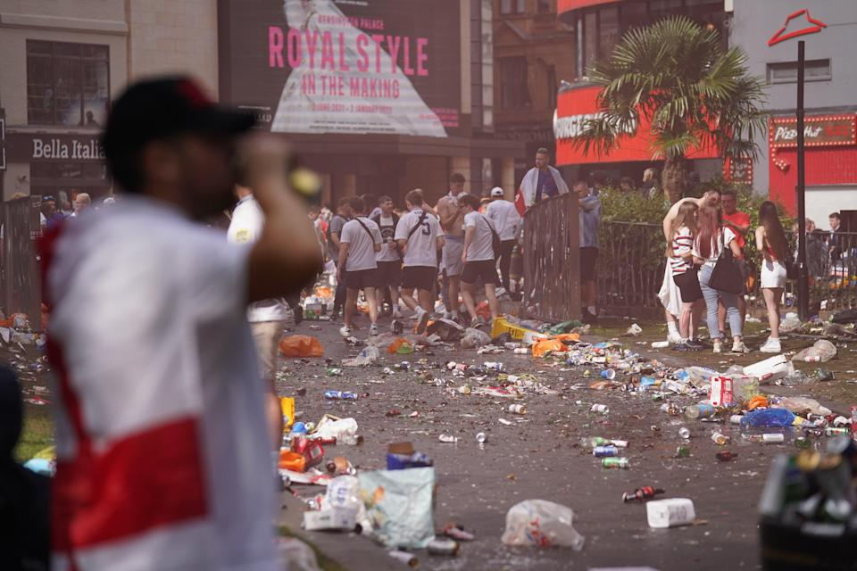Piles of rubbish left behind by partying England fans in Leicester Square (PA Wire)