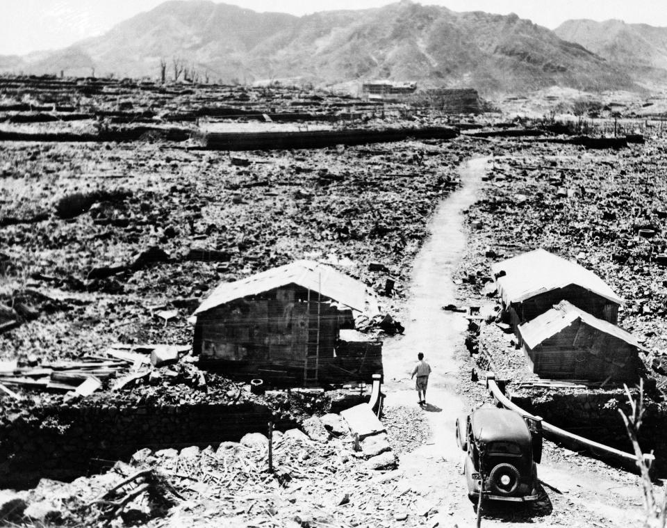 FILE - This Sept. 14, 1945, file photo shows shacks made from scraps of debris from buildings that were leveled in the aftermath of the atomic bomb that was dropped over Nagasaki. The city of Nagasaki in southern Japan marks the 75th anniversary of the U.S. atomic bombing of Aug. 9, 1945. It was a second nuclear bomb dropped by the U.S. three days after it made the world's first atomic attack on Hiroshima. (AP Photo, File)