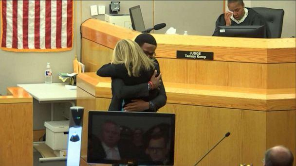 PHOTO: Botham Jean's brother Brandt hugs Amber Guyger after her sentencing, Oct 2, 2019. (ABC News)