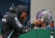 Mercedes driver Lewis Hamilton of Britain reacts after winning the Formula One Turkish Grand Prix at the Istanbul Park circuit racetrack in Istanbul, Sunday, Nov. 15, 2020. (AP Photo/Kenan Asyali, Pool)