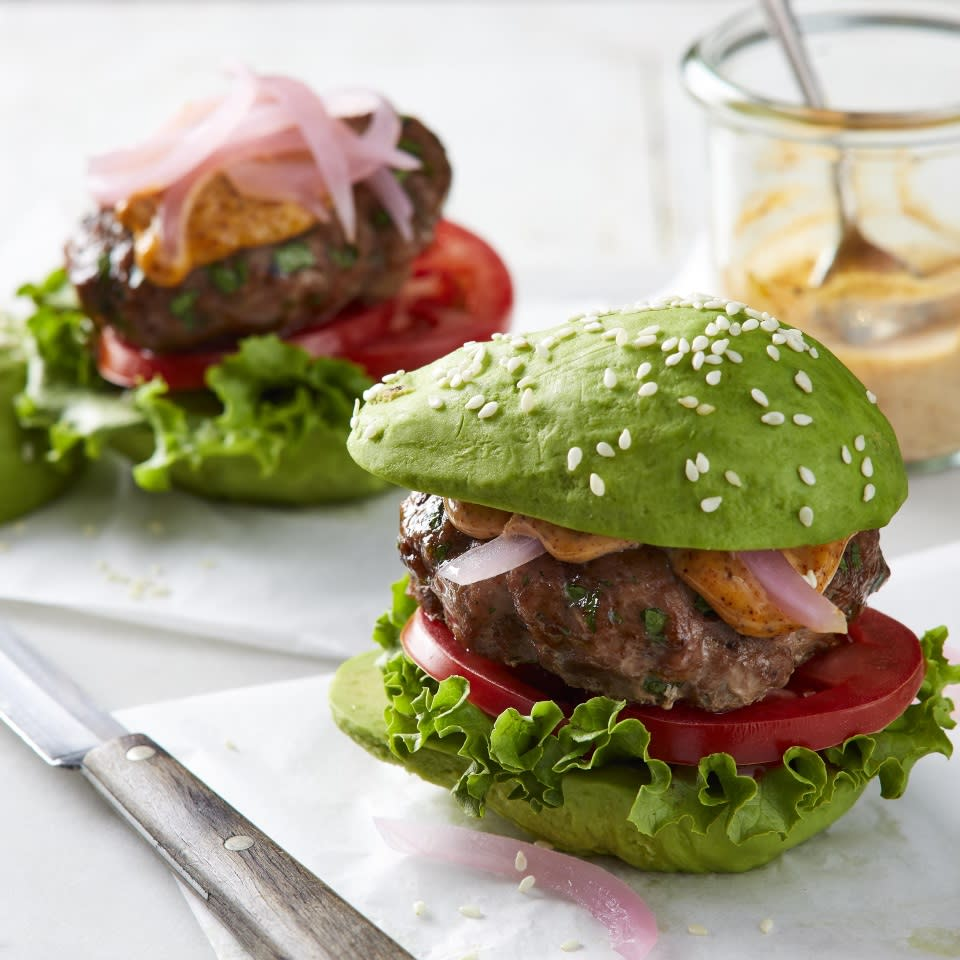 <p>Instead of being served on traditional buns, these turkey sliders are sandwiched inside mini avocados for a clever (and low-carb) meal--because why put avocado on your burger when you can put your burger on an avocado? Quick pickled onions are a pretty and tasty topping, and chipotle mayo seals the deal. Bonus: The burgers are cooked on a baking sheet, so it's easy to whip up a whole batch.</p>