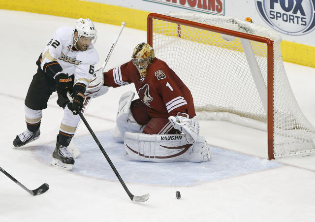 Anaheim Ducks' Patrick Maroon (62) is unable to score against Phoenix Coyotes goalie Thomas Greiss (1) during the second period of an NHL hockey game, Saturday, Jan. 11, 2014, in Glendale, Ariz. (AP Photo/Matt York)
