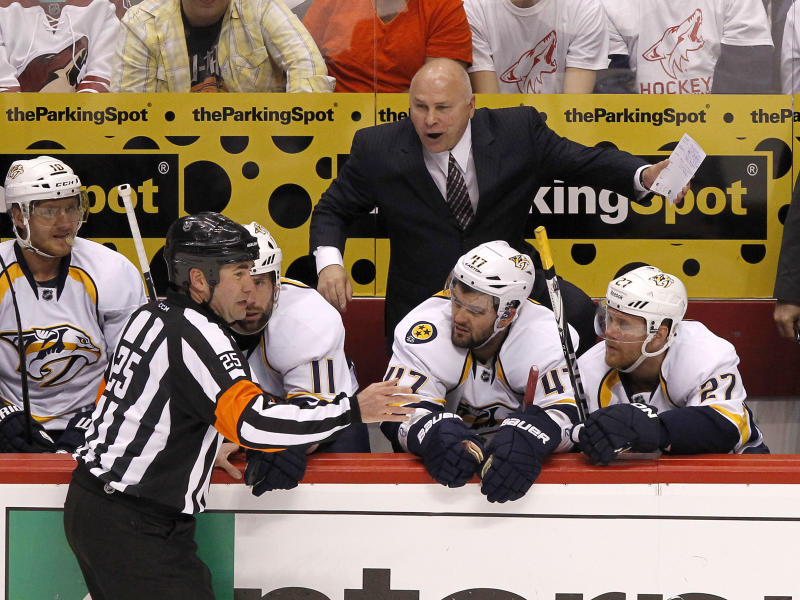 Nashville Predators head coach Barry Trotz, top, argues about a penalty call with referee Marc Joannette (25) as Martin Erat (10), of the Czech Republic, David Legwand (11), Alexander Radulov (47), of Russia, and Patric Hornqvist (27), of Sweden, listen in during the first period in Game 2 in an NHL hockey Stanley Cup Western Conference semifinal playoff series against the Phoenix Coyotes, Sunday, April 29, 2012, in Glendale, Ariz. The Coyotes won 5-3. (AP Photo/Ross D. Franklin)