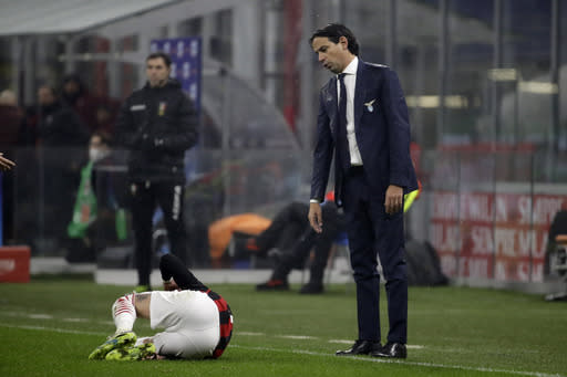 Lazio's head coach Simone Inzaghi reacts as player AC Milan's Samu Castillejo lies on the ground during a Serie A soccer match between AC Milan and Lazio, at the San Siro stadium in Milan, Italy, Wednesday, Dec. 23, 2020. (AP Photo/Luca Bruno)