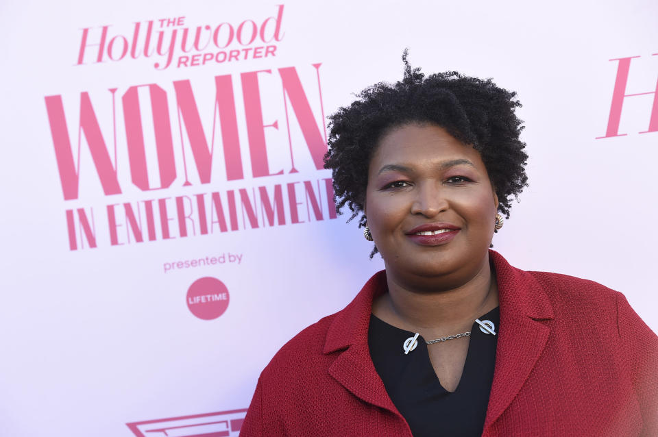 "FILE - Stacey Abrams arrives at The Hollywood Reporter's Women in Entertainment Breakfast Gala in Los Angeles on Dec. 11, 2019. Berkley announced Tuesday that it had acquired rights to three out-of-print novels by Abrams that she had written nearly 20 years ago under the name Selena Montgomery. Berkley, a Penguin Random House imprint, will begin reissuing the books; ""Rules of Engagement,"" ""The Art of Desire"" and ""Power of Persuasion,"" in 2022. (Photo by Jordan Strauss/Invision/AP, File)"