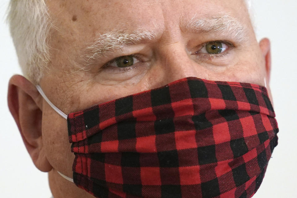 Minnesota Gov. Tim Walz wears his buffalo plaid cloth mask during questions at a press conference to announce statewide mask mandate, Wednesday, July 22, 2020, to help slow the spread of COVID-19. (Anthony Souffle/Star Tribune via AP)