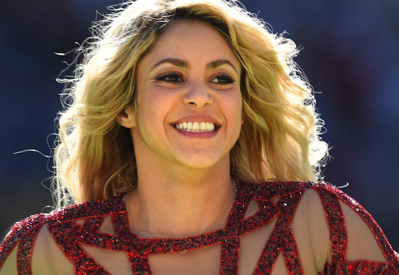 Colombian singer Shakira performs during the Closing Ceremony before the FIFA World Cup 2014 final soccer match between Germany and Argentina at the Estadio do Maracana in Rio de Janeiro, Brazil, 13 July 2014. Photo:Marcus Brandt/dpa (RESTRICTIONS APPLY: Editorial Use Only, not used in association with any commercial entity - Images must not be used in any form of alert service or push service of any kind including via mobile alert services, downloads to mobile devices or MMS messaging - Images must appear as still images and must not emulate match action video footage - No alteration is made to, and no text or image is superimposed over, any published image which: (a) intentionally obscures or removes a sponsor identification image; or (b) adds or overlays the commercial identification of any third party which is not officially associated with the FIFA World Cup) EDITORIAL USE ONLY | usage worldwide (Photo by Marcus Brandt/picture alliance via Getty Images)