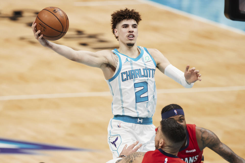 Charlotte Hornets guard LaMelo Ball (2) drives to the basket during the second half of an NBA basketball game against the New Orleans Pelicans, Sunday, May 9, 2021, in Charlotte, N.C. (AP Photo/Brian Westerholt)
