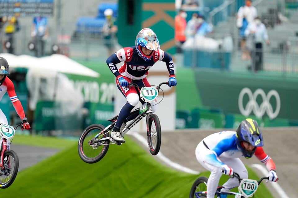 Connor Fields, center, races during the men's BMX semifinal race at the Tokyo Olympics.