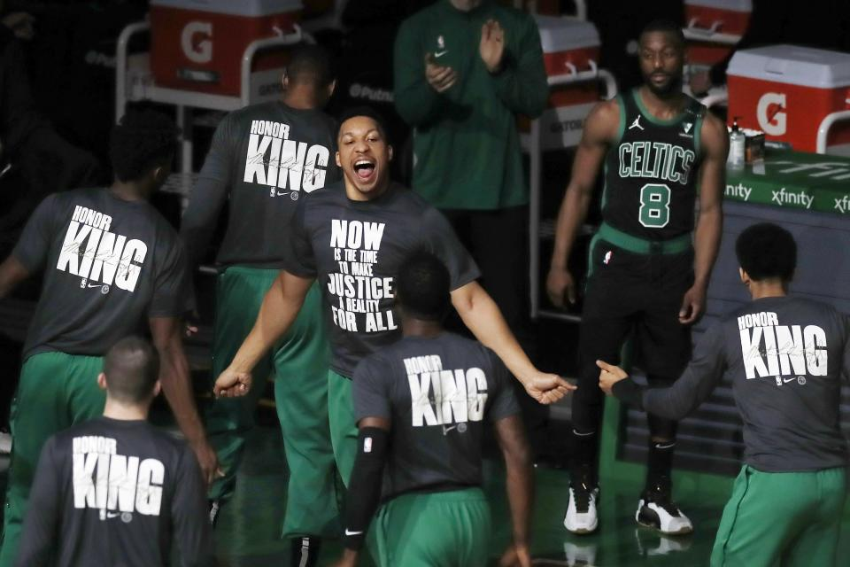 Boston Celtics' Grant Williams, center, rallies with teammates before an NBA basketball game against the New York Knicks, Sunday, Jan. 17, 2021, in Boston. (AP Photo/Michael Dwyer)