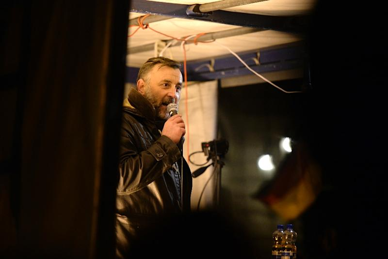 """PEGIDA, short for """"Patriotic Europeans Against the Islamisation of the Occident,"""" started life as a xenophobic Facebook group around co-founder Lutz Bachmann, 42, pictured at a protest rally on October 12, 2015 in Dresden (AFP Photo/Robert Michael)"""