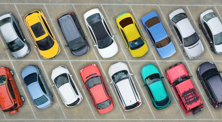 assortment of cars in a parking lot