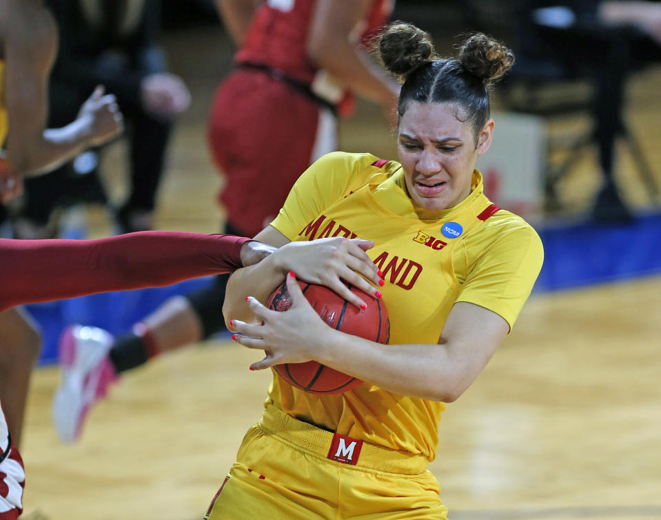 CORRECTS THE DATE TO MARCH 24, NOT MARCH 23 AS ORIGINALLY SENT - Maryland forward Mimi Collins (2) grabs a rebound during the first half of a college basketball game against Alabama in the second round of the women's NCAA tournament at the Greehey Arena in San Antonio on Wednesday, March 24, 2021. (AP Photo/Ronald Cortes)