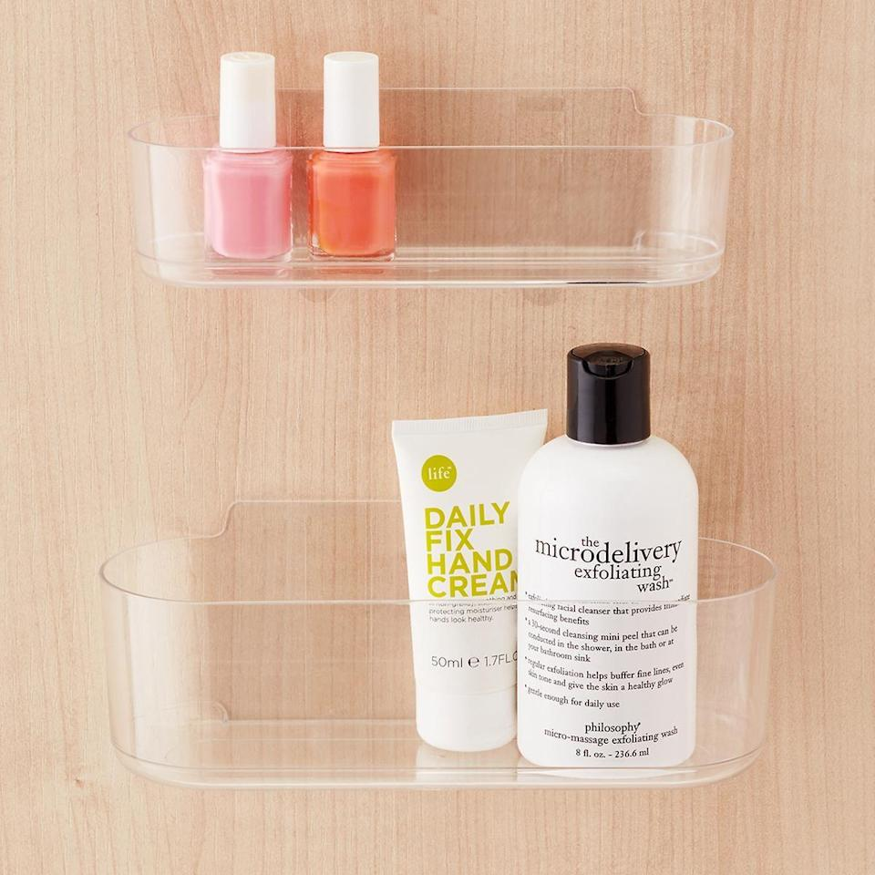 <p>Hang this <span>3M Command Clear Caddy</span> ($5-$9) inside your bathroom cabinets.</p>