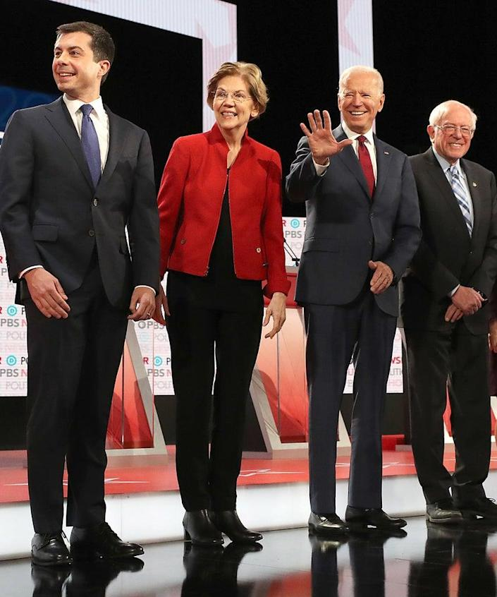 LOS ANGELES, CALIFORNIA – DECEMBER 19: Democratic presidential candidates (L-R) Andrew Yang, South Bend, Indiana Mayor Pete Buttigieg, Sen. Elizabeth Warren (D-MA), former Vice President Joe Biden, Sen. Bernie Sanders (I-VT), Sen. Amy Klobuchar (D-MN), and Tom Steyer await the start of the Democratic presidential primary debate at Loyola Marymount University on December 19, 2019 in Los Angeles, California. Seven candidates out of the crowded field qualified for the 6th and last Democratic presidential primary debate of 2019 hosted by PBS NewsHour and Politico. (Photo by Mario Tama/Getty Images)