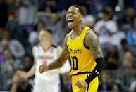 <p>Jairus Lyles #10 of the UMBC Retrievers reacts after a score against the Virginia Cavaliers during the first round of the 2018 NCAA Men's Basketball Tournament at Spectrum Center on March 16, 2018 in Charlotte, North Carolina. (Photo by Streeter Lecka/Getty Images) </p>