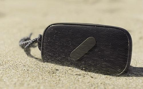 Super M speaker in sand