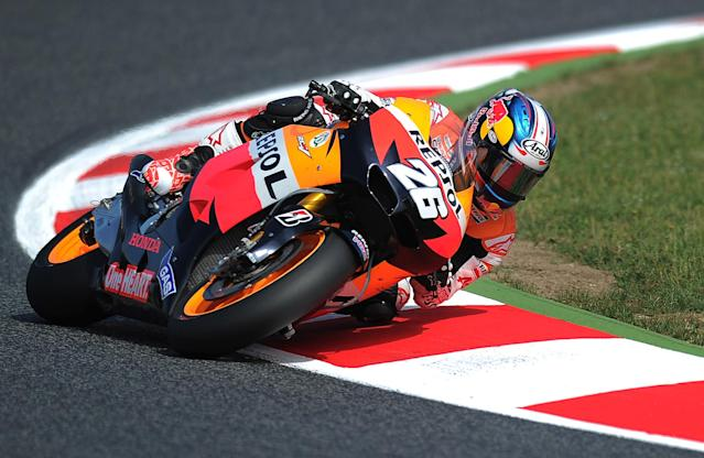 Repsol Honda Team's Spanish Dani Pedrosa rides at the Catalunya racetrack in Montmelo, near Barcelona, on June 2, 2012, during the MotoGP third training session of the Catalunya Moto GP Grand Prix. AFP PHOTO/LLUIS GENELLUIS GENE/AFP/GettyImages
