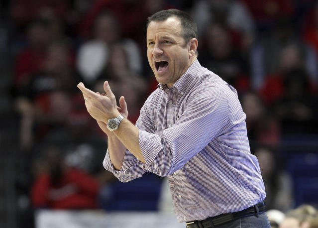 Louisville coach Jeff Walz urges his team on during the second half of an NCAA women's college basketball tournament regional semifinal against Stanford, Friday, March 23, 2018, in Lexington, Ky. (AP Photo/James Crisp)