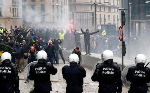 Far-right supporters face off with police in Brussels - Credit: REUTERS/Francois Lenoir