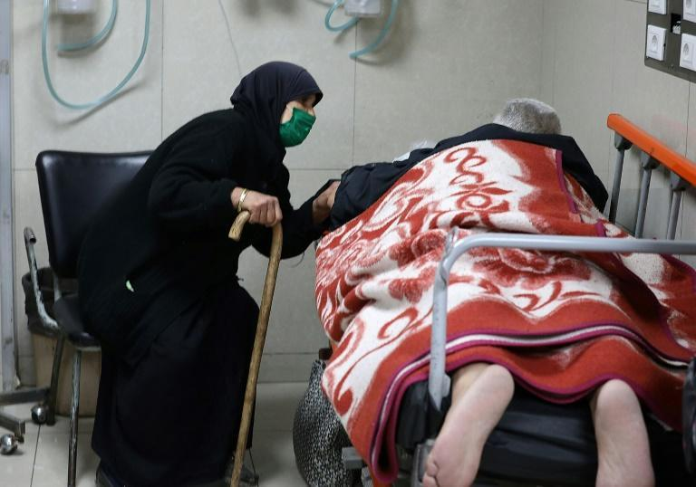 Syrians suspected of being infected with Covid-19 receive treatment at Mouwasat hospital in Damascus