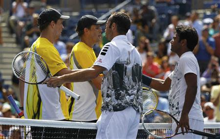 Paes of India and Stepanek of the Czech Republic are congratulated by Bob and Mike Bryan of the U.S. in their men's doubles match at the U.S. Open tennis championships in New York