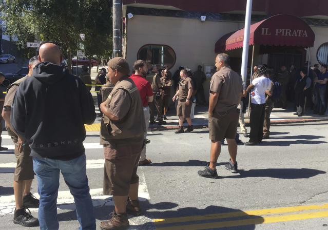 <p>UPS workers gather outside after a reported shooting at a UPS warehouse and customer service center in San Francisco on Wednesday, June 14, 2017. (AP Photo/Eric Risberg) </p>