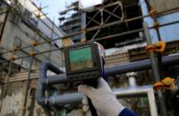A Geiger counter shows a radiation level of 231 microsieverts per hour near the damaged No. 3 reactor building at the tsunami-crippled Fukushima Daiichi nuclear power plant in Okuma town, Fukushima prefecture