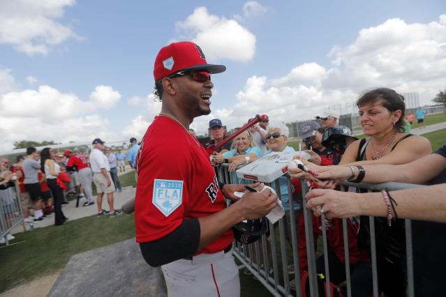 Boston Red Sox shortstop Xander Bogaerts signs autographs during their first full squad workout at their spring training baseball facility in Ft. Myers, Fla., Monday, Feb. 18, 2019. (AP Photo/Gerald Herbert)