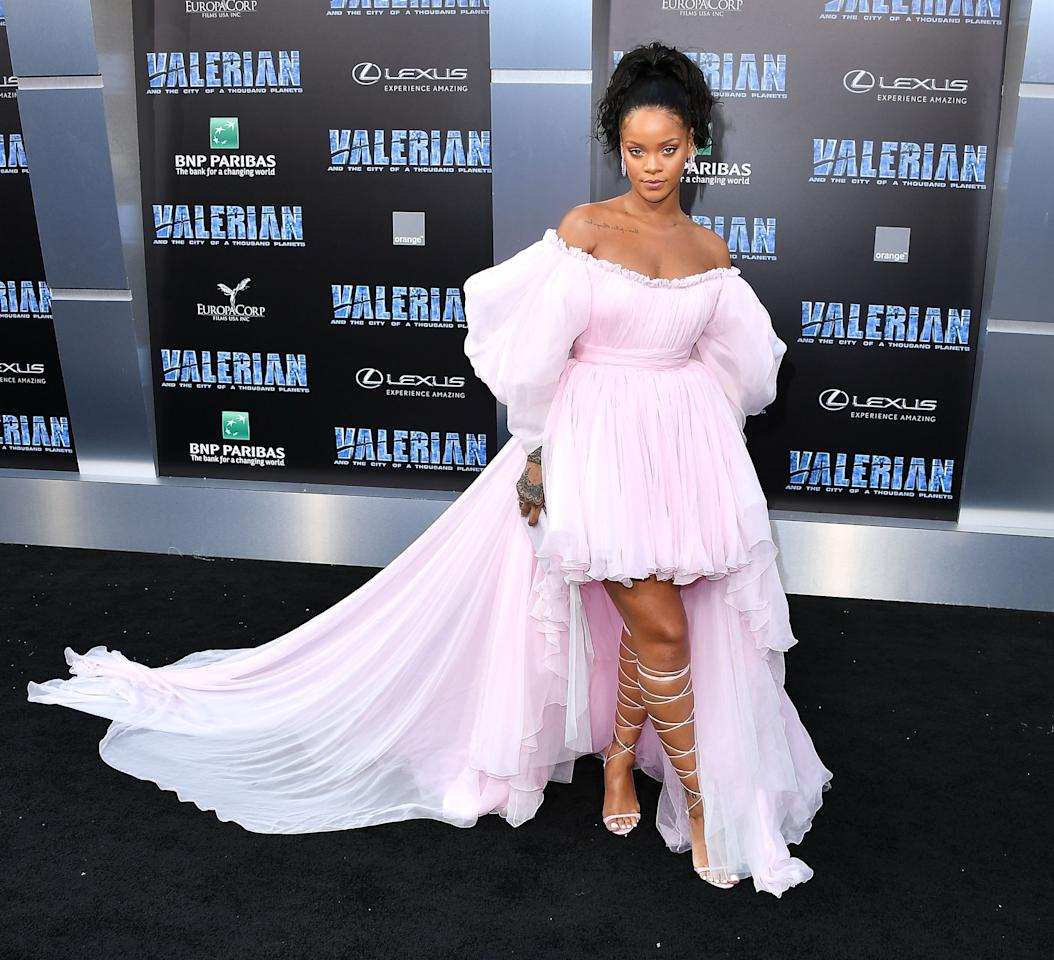 <p>Rihanna has transformed into the queen of frou-frou dressing, wearing a puffy pink Giambattista Valli gown and lace-up Manolo Blahnik sandals.<br /><i>[Photo: Getty]</i> </p>