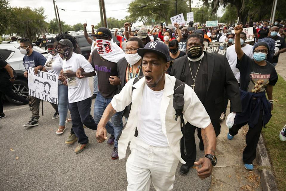 Malik Muhammad, centre, joins a rally to protest the shooting of Ahmaud Arbery. Source: AP