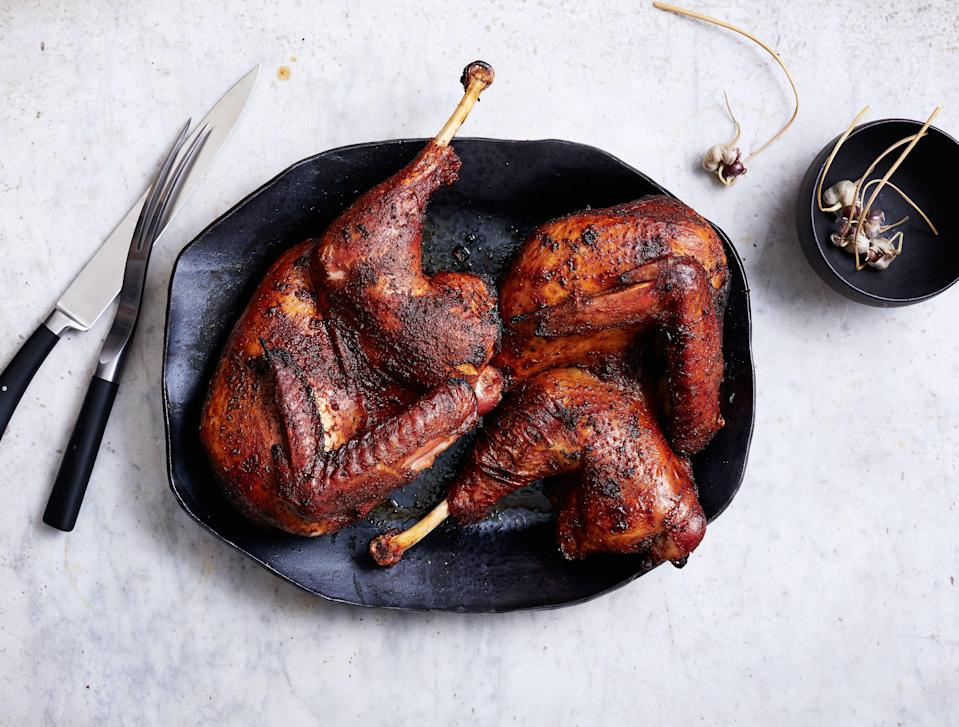 """Also known as the one-hour turkey, this spatchcocked bird (ask your butcher) will free up your oven. <a href=""""https://www.bonappetit.com/recipe/barbecue-spice-brined-grilled-turkey?mbid=synd_yahoo_rss"""" rel=""""nofollow noopener"""" target=""""_blank"""" data-ylk=""""slk:See recipe."""" class=""""link rapid-noclick-resp"""">See recipe.</a>"""