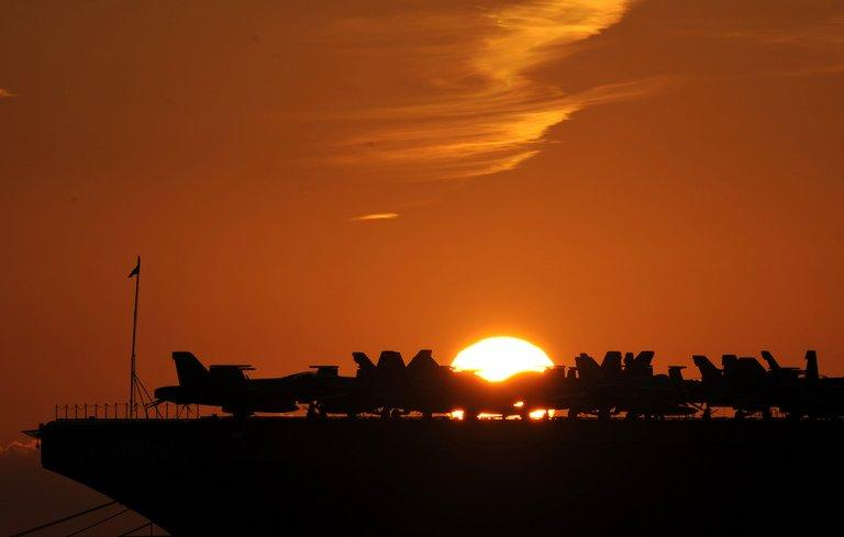 Planes are parked on the deck of the USS George H.W. Bush aircraft carrier in Marseille, France, on November 27, 2011