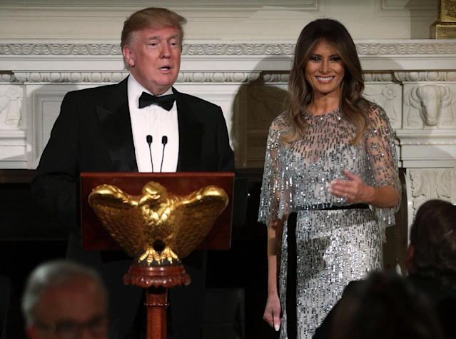 President Trump and first lady Melania Trump address their guests at the White House Thursday. (Photo by Alex Wong/Getty Images)