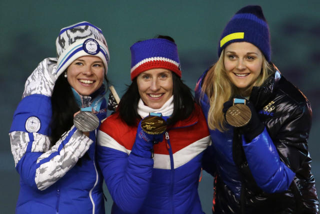 <p>From left, Finland's Krista Parmakoski, silver, Norway's Marit Bjoergen, gold, and Sweden's Stina Nilsson, bronze, pose for photos during the medals ceremony for the women's 30k cross-country skiing at the closing ceremony of the 2018 Winter Olympics in Pyeongchang, South Korea, Sunday, Feb. 25, 2018. (AP Photo/Natacha Pisarenko) </p>