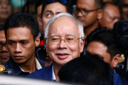 Malaysia's former prime minister Najib Razak leaves after giving a statement to the Malaysian Anti-Corruption Commission (MACC) in Putrajaya, Malaysia May 22, 2018. REUTERS/Lai Seng Sin