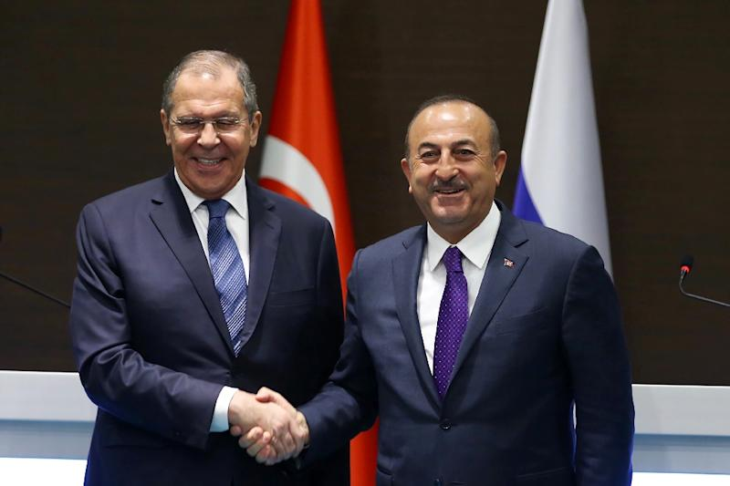 Russian Foreign Minister Sergei Lavrov (left) meets his Turkish counterpart Mevlut Cavusoglu in Antalya (AFP Photo/HO)