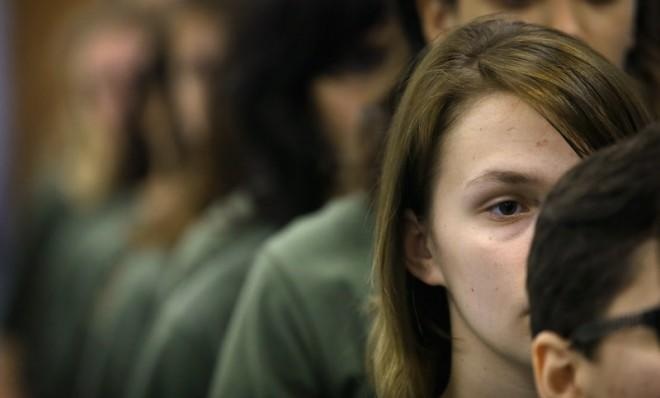Female Marine recruits wait for a dental examination on their first full day of boot camp in February in South Carolina.