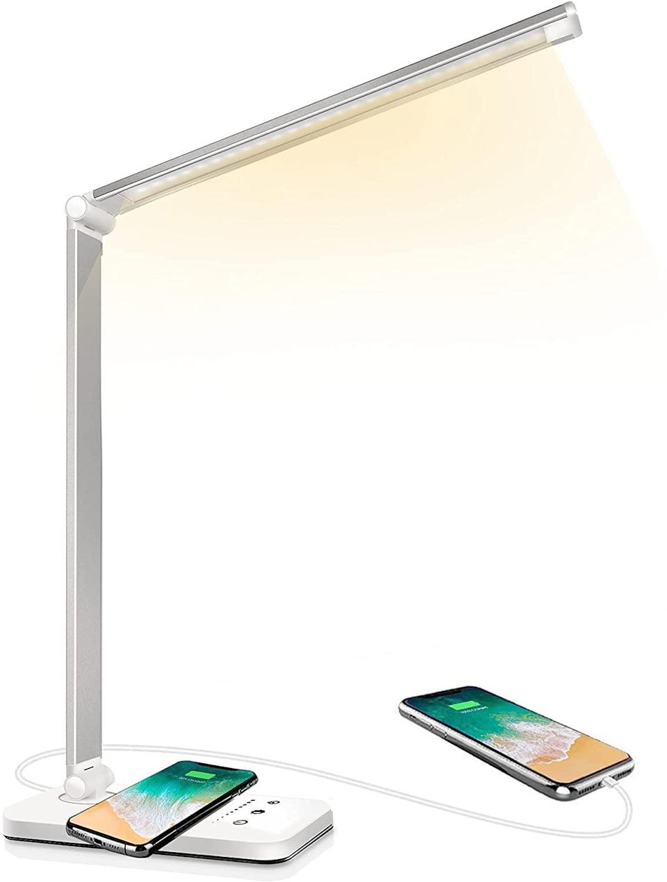<p>Whether they're a student or a young professional, a sleek lamp like the <span>LED Desk Lamp With Wireless Charger</span> ($27) does more than just provide light. It's also wireless charger and has a USB port for extra charging. The lamp has ten brightness levels, five lighting modes, multidirectional adjusting, and has an auto timer for when they fall asleep while studying. </p>