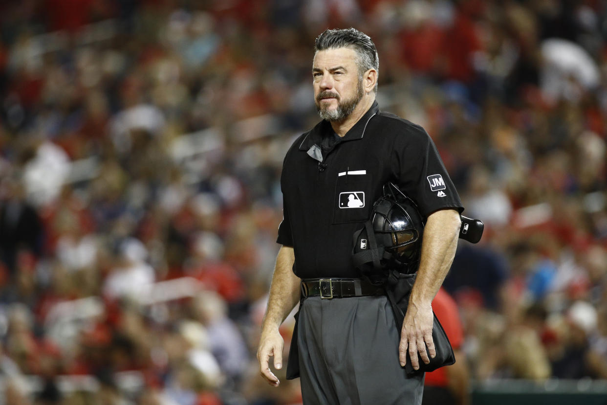 Umpire Rob Drake stands on the field in the x inning of a baseball game between the Atlanta Braves and the Washington Nationals, Friday, Sept. 13, 2019, in Washington. (AP Photo/Patrick Semansky)