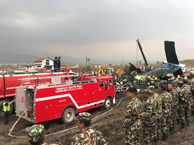 <p>Wreckage of an airplane is pictured as rescue workers operate at Kathmandu airport, Nepal, March 12, 2018. (Photo: Navesh Chitrakar/Reuters) </p>