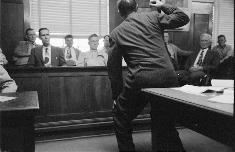 Lawyer discussing inside a trial court during the murder trial of Hunter Bergman, Texas, United States, 1952(Photo by Robert W Kelley/The LIFE Picture Collection via Getty Images)