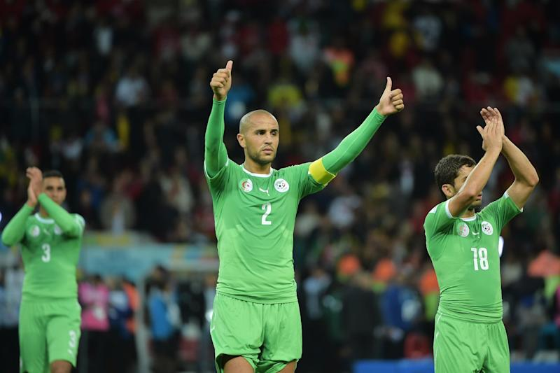 Algeria defender and captain Madjid Bougherra (C) gestures to the crowd after losing their Round of 16 football match against Germany at Beira-Rio Stadium in Porto Alegre during the 2014 FIFA World Cup on June 30, 2014