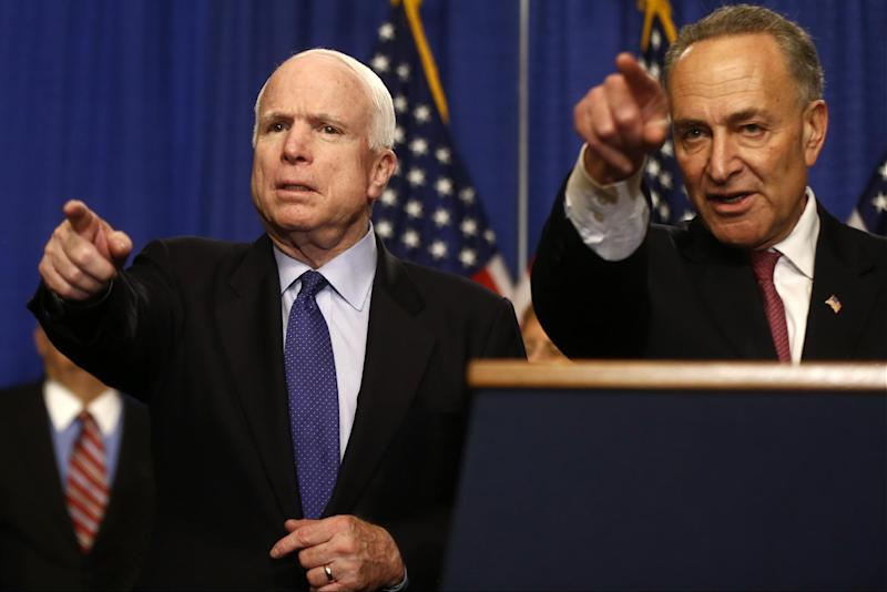 Sen. John McCain, R-Ariz., left, and Sen. Charles Schumer, D-N.Y. take questions during a news conference on immigration reform legislation, Thursday, April 18, 2013, on Capitol Hill in Washington. (AP Photo/Charles Dharapak)