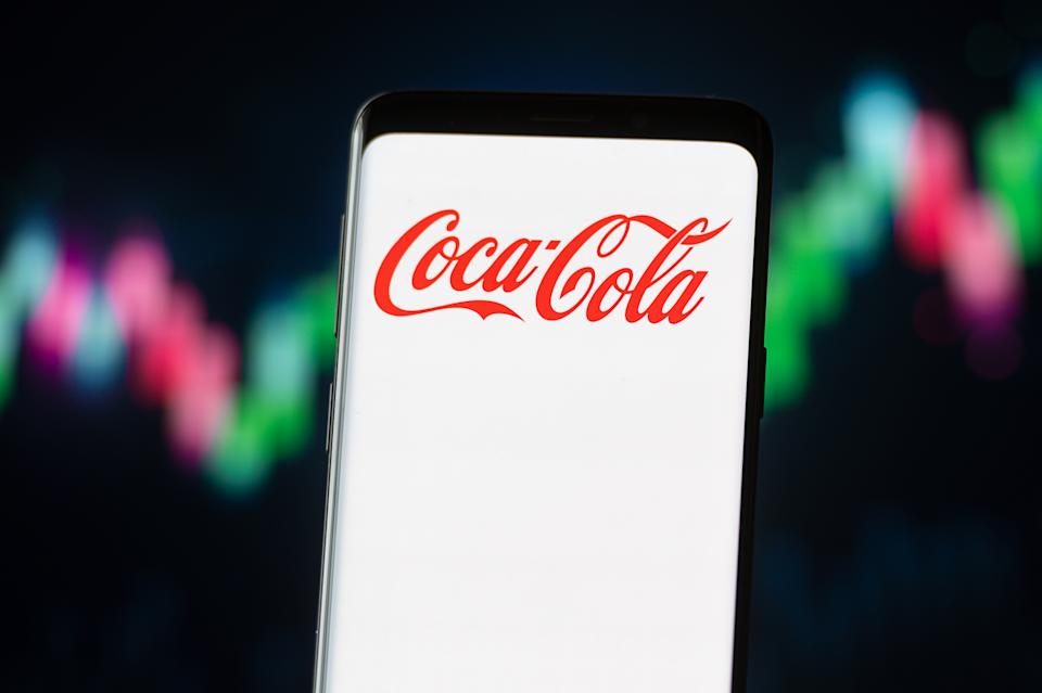 POLAND - 2020/11/04: In this photo illustration a Coca Cola logo seen displayed on a smartphone. (Photo Illustration by Mateusz Slodkowski/SOPA Images/LightRocket via Getty Images)