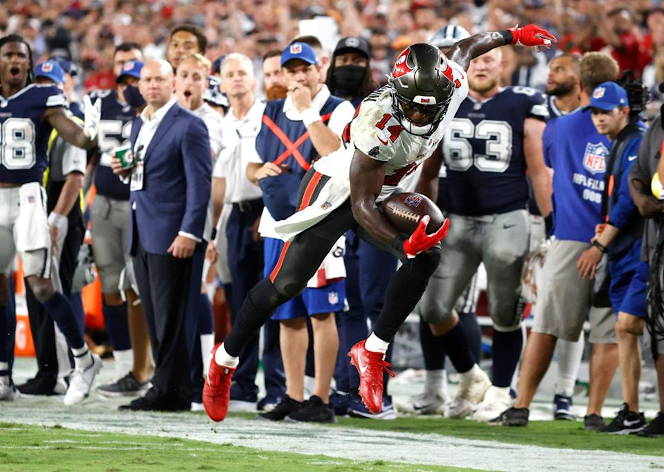 Tampa Bay Buccaneers wide receiver Chris Godwin (14) runs the ball against the Dallas Cowboys during the second half at Raymond James Stadium.